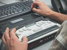 photo of person using a keyboard