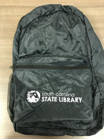 image of black backpack with state library logo